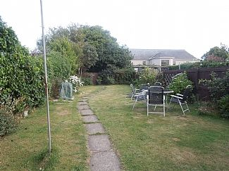 Large rear enclosed garden with BBQ