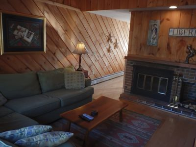 Another view of our living room with its wood burning fireplace & rustic decor!