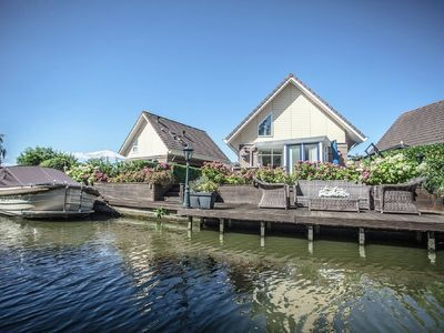 Photo for Bungalow with a dock surrounded by water