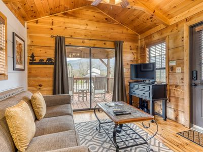 Photo for Cozy cabin with private hot tub and fire pit - close to national park & hiking!