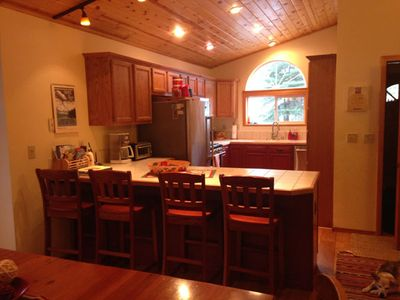 Newly remodeled kitchen with all new appliances and wide-plank wood floors