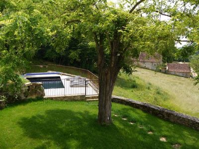 Photo for restored stone cottage near Sarlat with heated pool and private garden