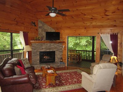 """Living area has stack rock fireplace with gas logs and 40"""" flat screen TV"""