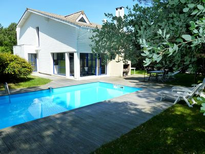 Photo for Contemporary villa with heated pool - close to golf and beaches