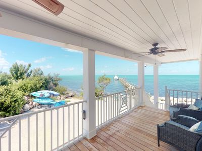 Photo for Gorgeous, recently updated, waterfront home with beach, pool, dock, & kayaks