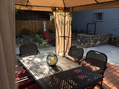 Outdoor dining table under canopy-rotisserie grill and propane bbque