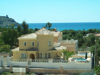 Photo for Apartment for family holidays, large terrace and pool, secure.