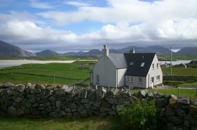 Airebroc with view of croft, beach and Uig mountains across the bay