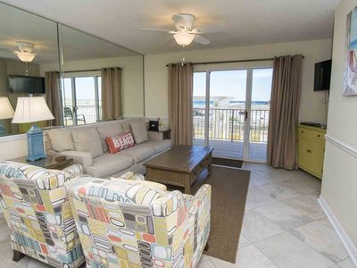 Photo for Beachfront Condo with Free Beach Service! Onsite Fitness Center and Tennis Court. Beachfront Pool