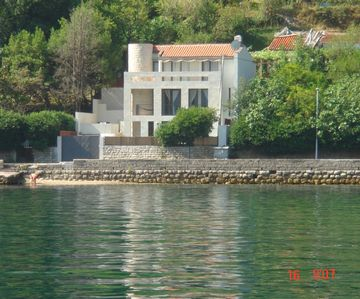 Photo for Lovely modern stone villa with pool on the sea front in Prcanj, ME