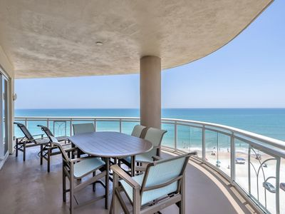 Photo for Stunning South East Oceanfront views and miles of sunny sandy beach, oceanfront grill, minutes to Daytona International Speedway.