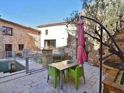 Photo for The charm of Provence with this typical house in stones with pool.