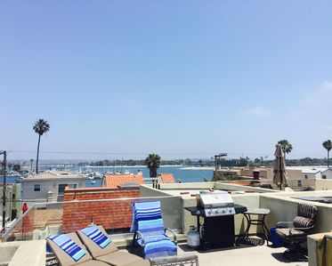 Photo for Time to Play in the Sun - Views from your Roof-top Deck of the Beach & Bay!