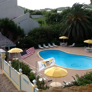 Roof top view of private pool complex, access to beach through privacy fence.