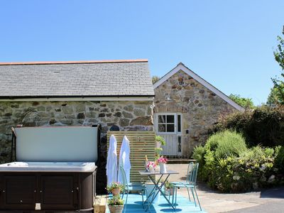 Photo for A gorgeous barn conversion with hot tub close to the South Coast of Cornwall.
