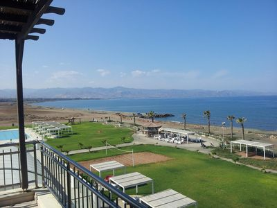Photo for Seafront penthouse apartment in award winning Aphrodite Beachfront Village