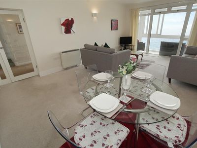 Photo for This smart contemporary coastal apartment has fabulous views over Langland Bay. Interiors are stylis