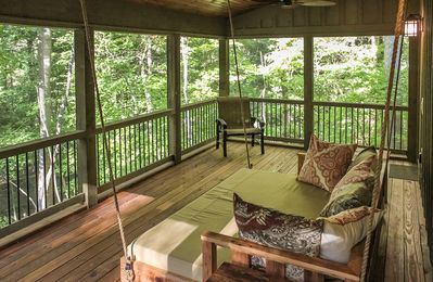 Queen sized Swing Bed on the Bunk House's screen porch.