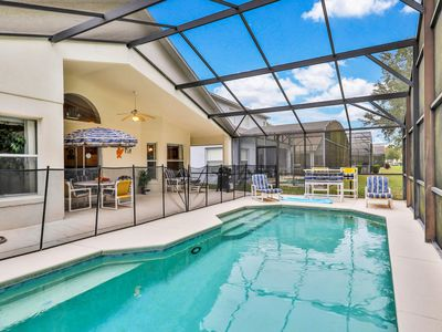 Photo for Gated home w/ private pool, furnished patio, close to Disney - snowbirds welcome