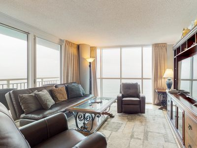 Photo for Oceanfront corner condo w/ great beach views & shared pools/hot tub/gym!