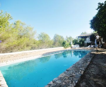 Photo for Typical Ibiza house, 2 bedrooms, swimming pool, barbecue ..