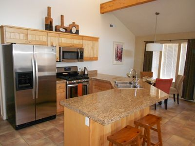 Kitchen centrally located for maximum entertainment. Seating for 6 people.