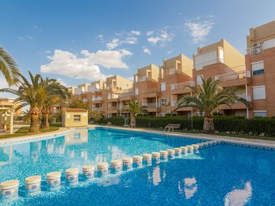 Photo for MED BAJO 30 Walking distance to the beach, Pool, AC, PK