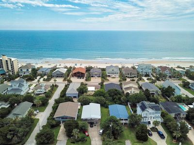 Photo for Beach house with private pool, 2 large screened porches, easy walk to beach