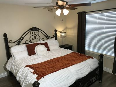 Master Bedroom With King Bed, HDTV, and Attached Bathroom