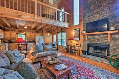 A picture-perfect riverfront getaway awaits at this exceptional Ellijay cabin.