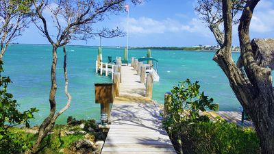 Photo for Your Own Private Island in the Florida Keys with dock, sandy beach and boat