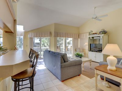 Photo for Bright, open home w/ access to a shared pool & hot tub - walk to the beach!