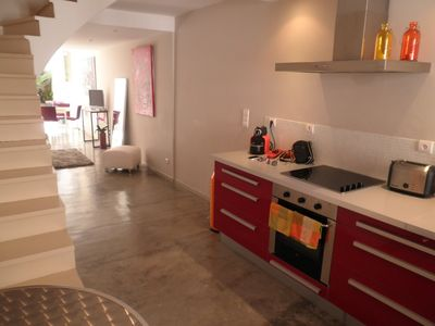 Photo for Charming village house with patio, inside the ramparts of Aigues Mortes