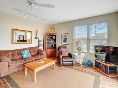 Photo for First-floor villa w/partial ocean views, covered porch -one block from the beach