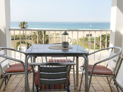 Photo for Set directly on the beach promenade of Conil, with stunning views over the beach