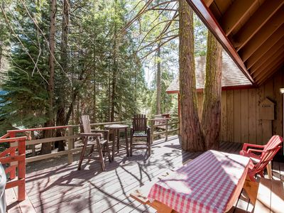 Photo for Cozy and authentic cabin in the forest with wood fireplace, walk to town!