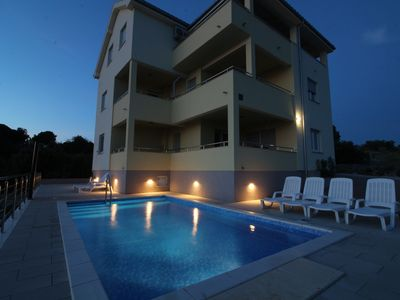 Photo for Holiday apartment with pool use and sea views