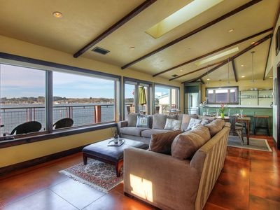 Photo for Bayfront condo with gorgeous views, decks, a shared hot tub, and firepit!