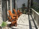 Front Deck Offers Plenty Of Shade and Sun and comfortable cedar chairs