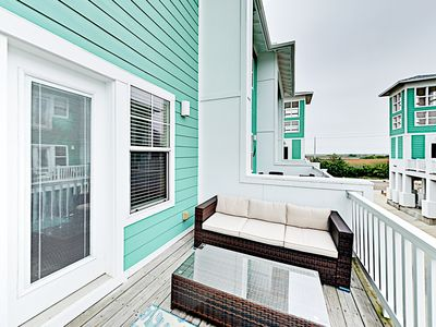 Deck - Find seating for 5 on the 2nd-story deck.