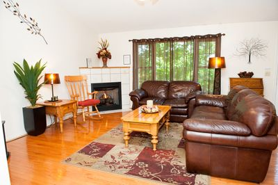 Living room with gas fire place. 55in TV 55in TV. movie library. DVD.