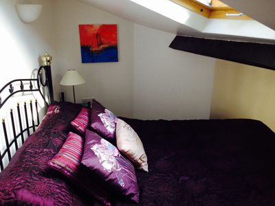 The Romantic Mezzanine Bedroom with low headroom and a view of the stars
