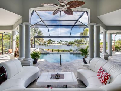 Photo for Elegant gulf access home with beautiful canal view, heated pool & large lanai
