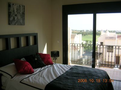 Master Bedroom With View of Golf Course
