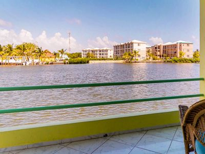 Photo for Sprawling lagoon-front villa with gorgeous views, shared pool, near small beach!