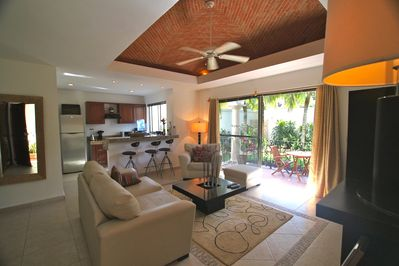Living room with traditional brick boveda ceiling and garden terrace!