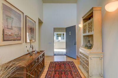 Entryway with modern artistic decor