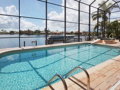 Photo for 15% OFF! SWFL Rentals - Villa Claire - 2 Story Gulf Access Pool Home Sleeps 6