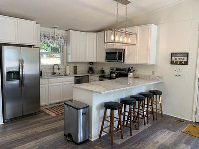 Newly Renovated Kitchen with Stainless Appliances, Quartz Tops & New Cabinets.