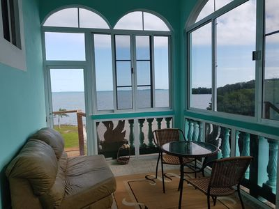 Photo for Enjoy BREATHTAKING VIEW OF THE CARIBBEAN SEA in this elegant See Belize SUNROOM PENTHOUSE!